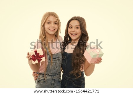 Girls open holiday present. Children cheerful hold presents. Opening gifts. Perfect present for teens. Shopping day. Birthday present. For my dear friend. Girls sisters or friends hold gift boxes.