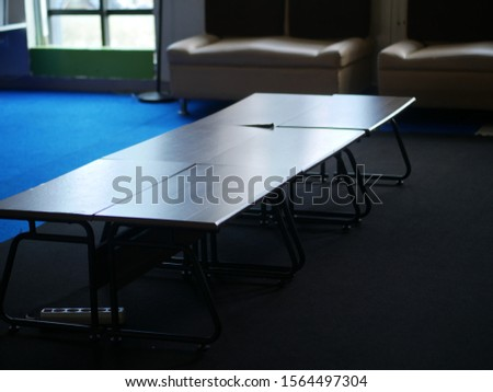Brown, light brown wooden table in the living room. Modern designer, table. #1564497304