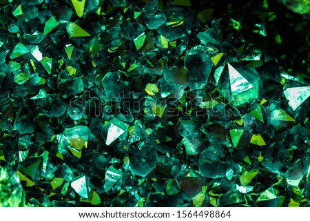 Emerald, Sapphire or Tourmaline green crystals. Gems. Mineral crystals in the natural environment. Stone of precious crystals on white background is insulated