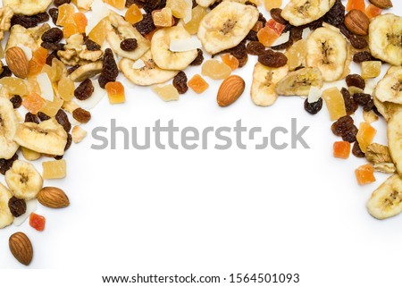 top view of dried fruits scattered on white background with copy space #1564501093