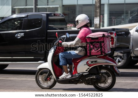 Chiangmai, Thailand -  October 29 2019: Delivery service man ride a Motercycle of Food Panda. On road no.1001, 8 km from Chiangmai city. #1564522825