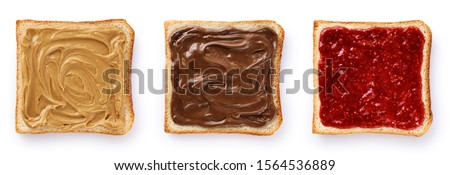 Toasts with chocolate butter, peanut butter and  berry jam isolated on white background. With clipping path. #1564536889