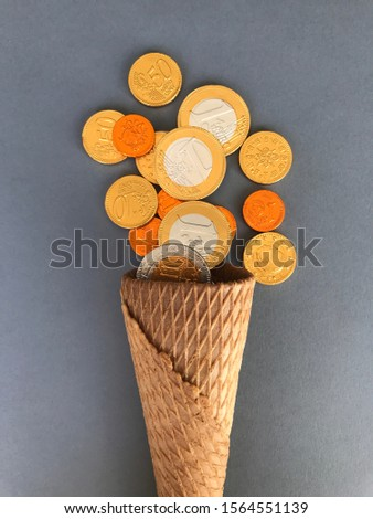 Sweet background. Waffle cone and chocolate coins. Pirate treasures.