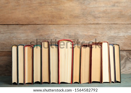 Collection of old books on wooden shelf #1564582792