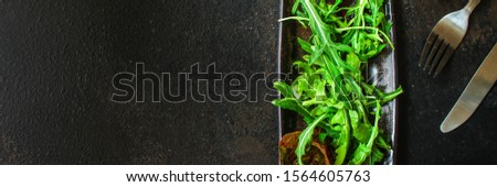 Healthy salad, leaves mix (mix micro greens, arugula, onion, other ingredients). food background. copy space #1564605763