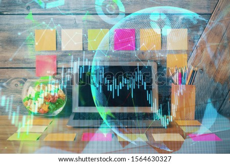 Double exposure of forex graph and work space with computer. Concept of international online trading. #1564630327