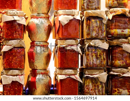 many glass jar of italian calabrian foods such as pepper, anchovy and more Royalty-Free Stock Photo #1564697914