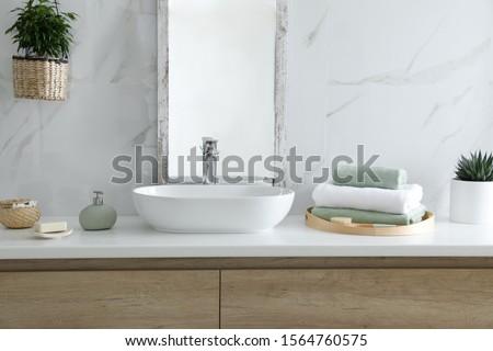 Modern bathroom interior with stylish mirror and vessel sink #1564760575