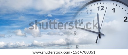 Clock face in blue sky. Time passing #1564780051