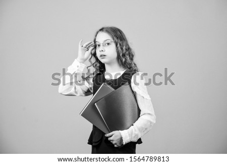 Check knowledge. Final exam coming. Girl hold textbook folder test. School exam concept. Prepare for exam. Preparing to exams in library. Small child formal wear. Formal education and homeschooling. #1564789813