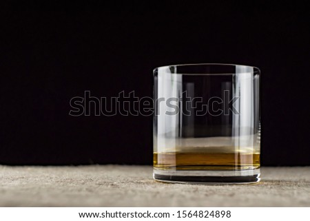 whiskey is poured into a glass #1564824898