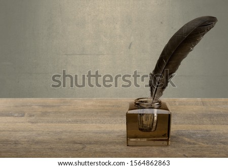 Vintage background with quill pen and inkwell on table #1564862863
