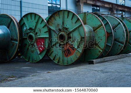 Many steel cable reels, industrial area with steel cable reels, old cable reels  #1564870060