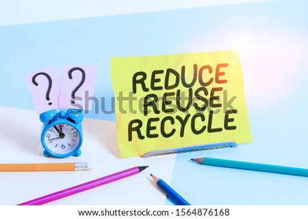 Text sign showing Reduce Reuse Recycle. Conceptual photo environmentallyresponsible consumer behavior Mini size alarm clock beside stationary placed tilted on pastel backdrop. #1564876168