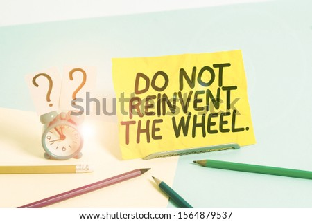Text sign showing Do Not Reinvent The Wheel. Conceptual photo stop duplicating a basic method previously done Mini size alarm clock beside stationary placed tilted on pastel backdrop. #1564879537