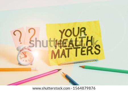 Text sign showing Your Health Matters. Conceptual photo good health is most important among other things Mini size alarm clock beside stationary placed tilted on pastel backdrop. #1564879876