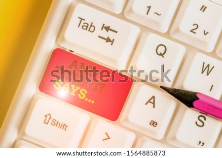 Handwriting text writing And The Survey Says. Concept meaning doing poll and bring the results discuss with others White pc keyboard with empty note paper above white background key copy space. #1564885873