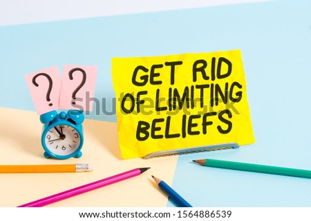 Text sign showing Get Rid Of Limiting Beliefs. Conceptual photo remove negative beliefs and think positively Mini size alarm clock beside stationary placed tilted on pastel backdrop. #1564886539