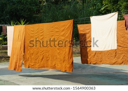 The robes of the Buddhist priests or monks on the clothes line, washing line, #1564900363