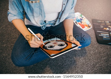 Lifestyle creative hobby and freelance artistic work job concept. Caucasian woman artist illustrator painting drawing on touch pad digital tablet with stylus. Process of creating illustration. #1564952350