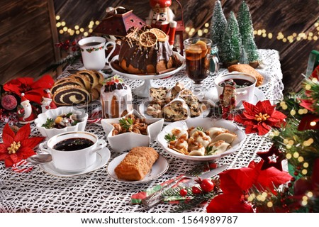 traditional dishes and cakes for Christmas Eve in Poland in rustic style Royalty-Free Stock Photo #1564989787