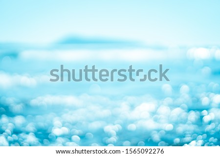 Copy space blur tropical beach with bokeh sun light wave on blue sky and white cloud abstract background. Summer vacation outdoor and travel holiday adventure concept. Vintage tone filter effect color #1565092276