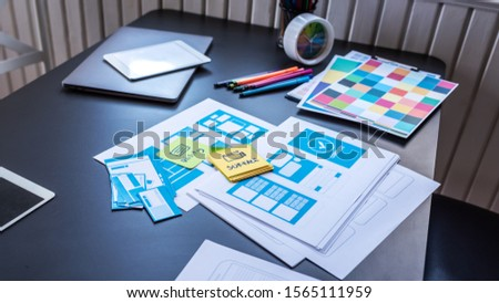 Desk of drawing wireframe for mobile user experience UX/UI design. #1565111959