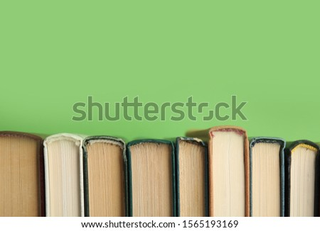 Collection of old books on green background, space for text #1565193169
