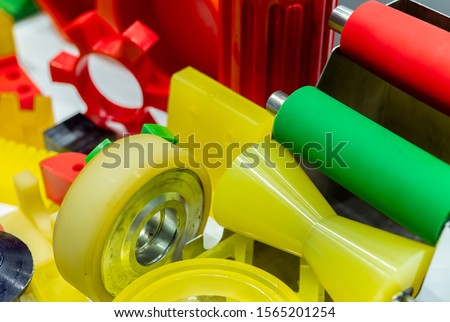 Engineering plastics. Plastic material used in manufacturing industry. Global engineering plastic market concept. Polyurethane and abs plastic parts materials. Plastic injection machine products.  #1565201254