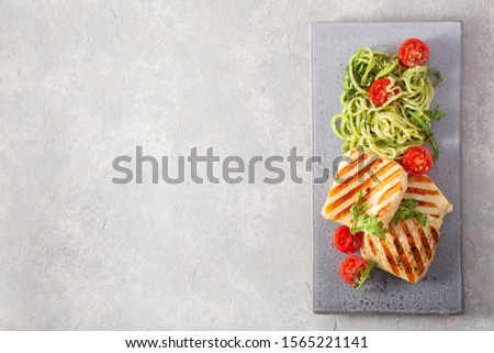 ketogenic paleo diet lunch. halloumi cheese, spiralized zucchini with arugula pesto and tomatoes #1565221141