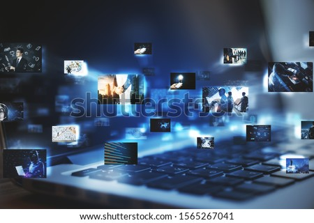 Close up of laptop with digital pictures on blurry dark background. Media photo gallery background. Double exposure Royalty-Free Stock Photo #1565267041