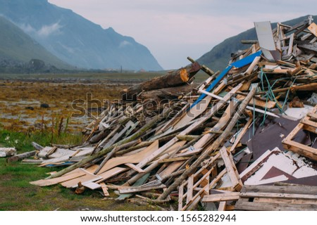 Big heap of different garbage near the sea on Lofoten Islands, Norway #1565282944