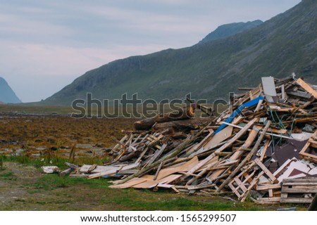 Big heap of different garbage near the sea on Lofoten Islands, Norway #1565299507