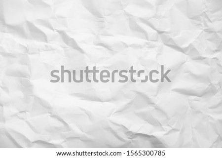 White crumpled paper texture background. Royalty-Free Stock Photo #1565300785