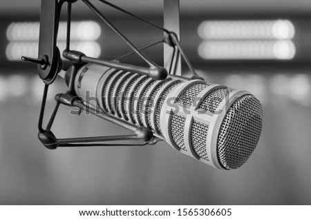 For radio station: professional microphone and sound mixer in radio station studio