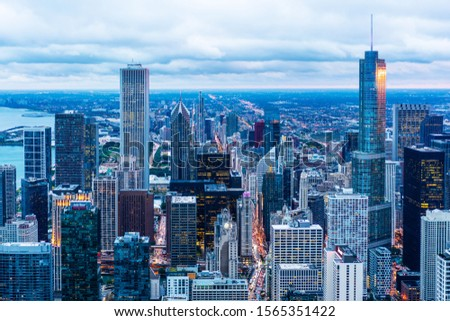 Business concept for real estate and corporate construction - panoramic urban city skyline aerial view under bright sky and beautiful sunset in Chicago, America