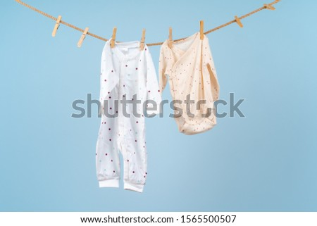 Cute toddler colorful clothing hang on a rope #1565500507