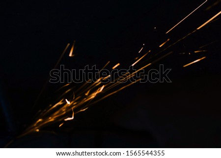 worker cuts a metal pipe by means of the abrasive tool #1565544355