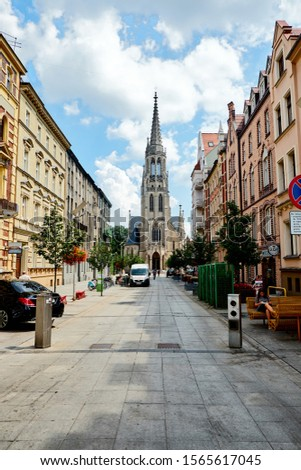 KATOWICE, POLAND - JULY 26, 2018 - St. Mary's street and cathedral #1565617045