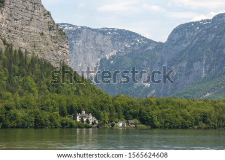 25 May 2019, Hallstatt, Austria. Overview of the lake and city, clouds over the mountains #1565624608