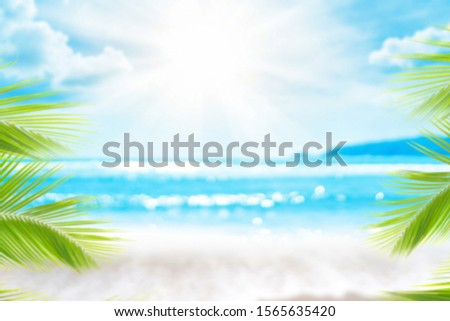 Blur beautiful nature green palm leaf on tropical beach with bokeh sun light wave abstract background. Copy space of summer vacation and business travel concept. Vintage tone filter effect color style #1565635420