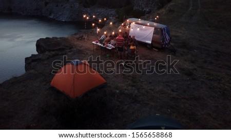 Tourists Frying Marshmallows at Camping Bonfire #1565658868