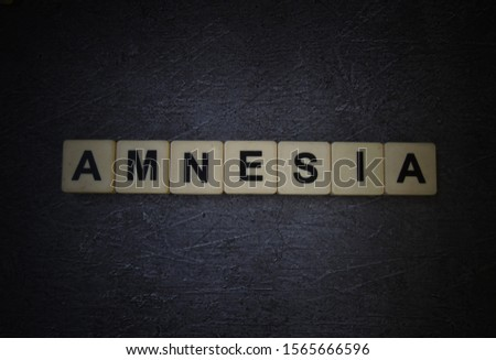 Amnesia, word cube with background. #1565666596