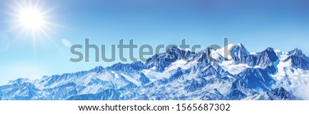winter Panorama of snowy alps mountains and summits #1565687302