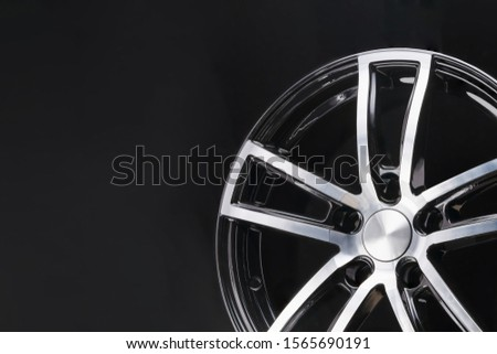 car cast aluminum alloy wheels, black silver with polished front, very beautiful and modern, fashion. Close-up on dark background, elements, spokes. #1565690191