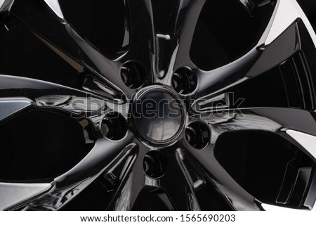 car cast aluminum alloy wheels, black silver with polished front, very beautiful and modern, fashion. Close-up on dark background, elements, spokes. Royalty-Free Stock Photo #1565690203