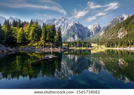 Scenic image of fairy-tale Mountain lake under sunlit. Amazing Nature Landscape. Wonderful sunny morning. Beautiful scenery of the majestic Fusine lakeside in Julian Alps. Perfect natural background #1565718082