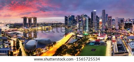 Singapore city panoranora at sunrise with Marina bay Royalty-Free Stock Photo #1565725534