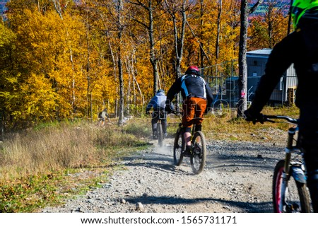 Bromont, Canada - October 14 2019: People riding bike with Colorful autumn view in Bromont mount in Quebec Canada #1565731171