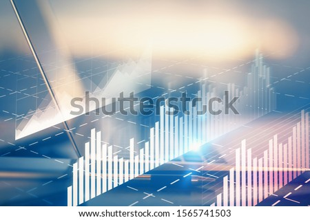 Forex graph hologram on table with computer background. Multi exposure. Concept of financial markets. Royalty-Free Stock Photo #1565741503